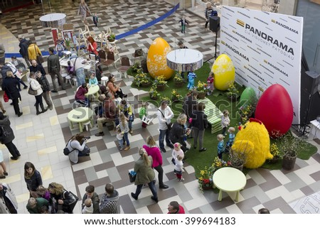 VILNIUS, LITHUANIA - APRIL 02, 2016: Eggs chickens  and spring flowers installations. Exhibition of domestic rabbits at the traditional Easter fair in the huge shopping center Panorama - stock photo