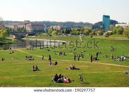 VILNIUS, LITHUANIA - APRIL 26 : The Vilnius city at weekend with resting people on April 26, 2014, Vilnius, Lithuania. - stock photo