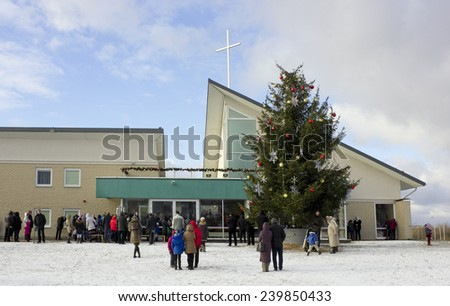 VILNIUS, LITHUANIA - DECEMBER 25, 2014: People came to a day Christmas prayer to Saint Josef's church, which was founded  in 1999. The sermon goes in the Lithuanian and Polish languages. - stock photo