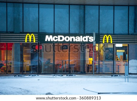 VILNIUS, LITHUANIA - JAN 11, 2016: McDonald's restauraunt in Vilnius. McDonald's is the world's largest chain of hamburger fast food restaurants, serving around 68 million customers daily. - stock photo