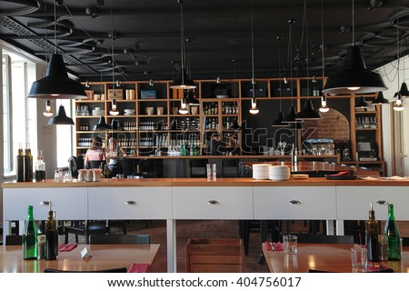 VILNIUS, LITHUANIA - JULY 21, 2015: People in the modern cafe with cozy interior and with open kitchen, Vilnius, Lithuania. - stock photo