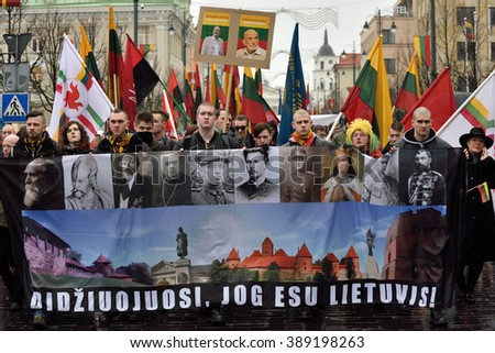 VILNIUS, LITHUANIA - MAR 11: Around one thousand people gathered with flags in a nationalist rally at Gedimino Avenue on Re-Establishment of Independence Day on March 11, 2016 in Vilnius, Lithuania - stock photo