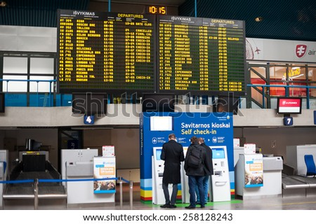 VILNIUS, LITHUANIA - MARCH 05: People waiting flight in Vilnius Airport on March 5, 2015, Vilnius, Lithuania - stock photo