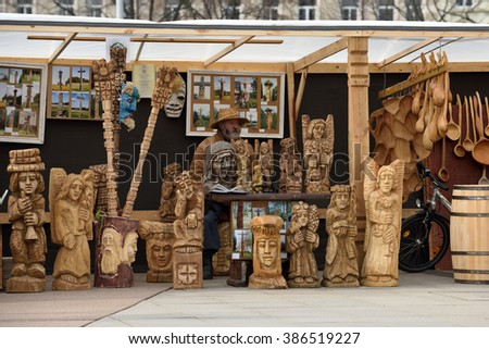 VILNIUS, LITHUANIA - MARCH 6: Unidentified people sell handmade souvenirs from carved wood in annual traditional crafts fair - Kaziuko fair on March 6, 2016 in Vilnius, Lithuania - stock photo