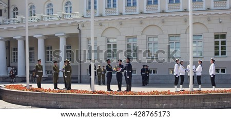 VILNIUS, LITHUANIA - MAY 29, 2016: Soldiers and seamen of armed forces and navy of the Republic of Lithuania prepare for solemn raising of national flags near the presidential palace - stock photo