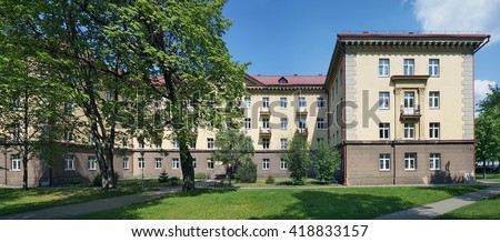 VILNIUS, LITHUANIA - MAY 10, 2016: The main dormitory of Medical Faculty of the State University among old maples and lindens trees. Sunny spring day - stock photo