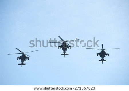 VILNIUS - MAR 22: US Army Apache AH-64 Helicopters during the Dragoon Ride Exercise on March 22, 2015 in Vilnius, Lithuania. The Boeing AH-64 Apache is a four-blade, twin-turboshaft attack helicopter. - stock photo