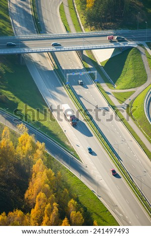 VILNIUS - OCTOBER 18: Aerial View of Highway (motorway) traffic on October 18, 2014 in Vilnius, Lithuania. A newly constructed street connect IXB transport corridor with Vilnius International Airport. - stock photo