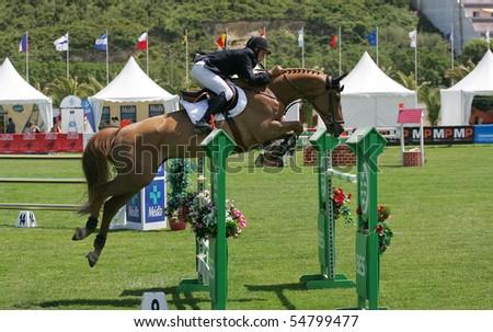 VIMEIRO, PORTUGAL - JUNE 5: Equestrian International Show Jumping 3* - Sebast Numminen  (FIN) June 5, 2010 in Vimeiro, Portugal - stock photo