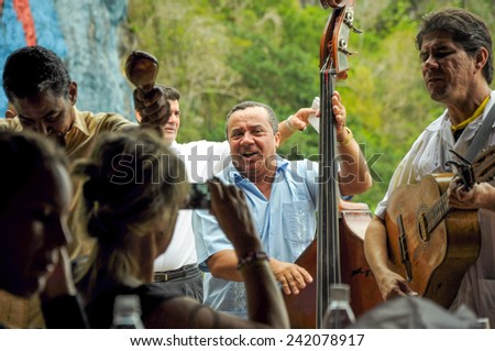 VINALES VALLEY, CUBA - JANUARY 19, 2013. Local Cuban band play Salsa while tourist eating in restaurant in Vinales Valley, Pinar Del Rio province in Cuba, famous for tobacco plantations and caves. - stock photo