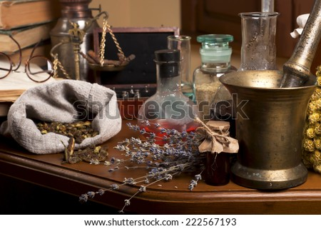 Vinatge copper mortar herbs on a wooden table  - stock photo