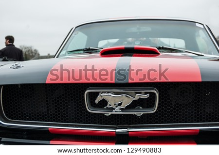 VINCENNES, FRANCE - JANUARY 6: Ford Mustang takes part in antique cars exhibition on January 6, 2013 in Vincennes, France. - stock photo