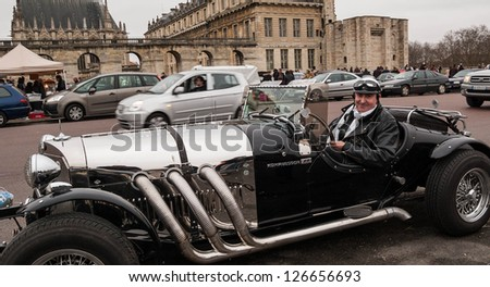 VINCENNES, FRANCE - JANUARY 6: Unidentified driver in a Mercedes Benz 720 SSK (1929) takes part in antique cars exhibition on January 6, 2013 in Vincennes, France. - stock photo