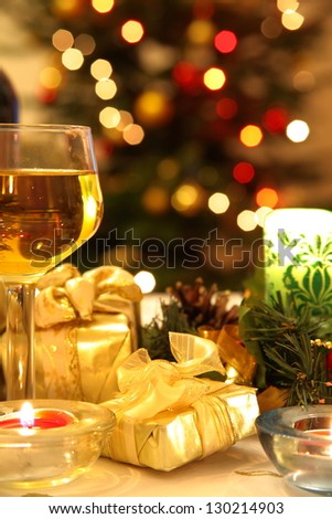 Vine and gifts on background with blurred lights. - stock photo
