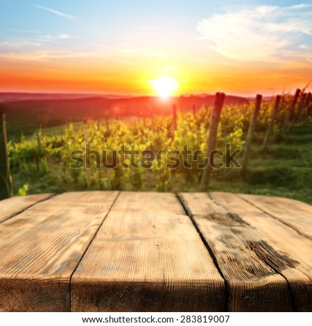 vineyard at sunset in the Chianti region in Italy and big table place  - stock photo