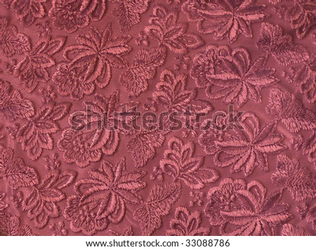Vinous guipure,  embroidery on cloth, texture - stock photo