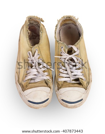 vintage age-worn sneakers on a white background with clipping path - stock photo