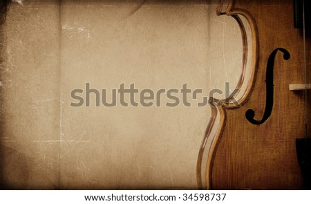 Vintage aged violin on textured background - stock photo