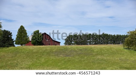 Vintage aging wooden barn in the Midwest - stock photo