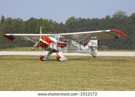 Vintage Aircraft Parked off the Runway - stock photo