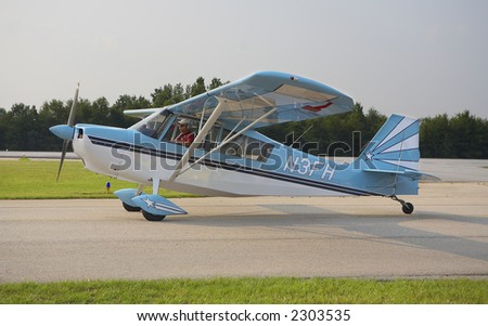 Vintage Airplane on the Runway - stock photo