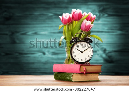 Vintage alarm clock close-up on wooden surface - stock photo