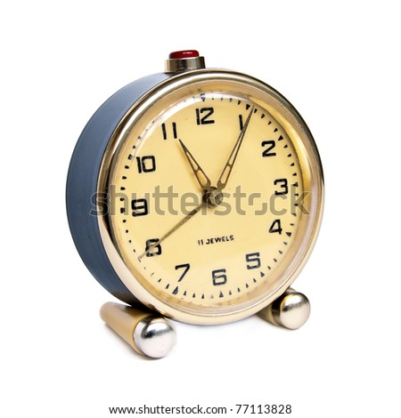 Vintage alarm clock isolated on white background - stock photo