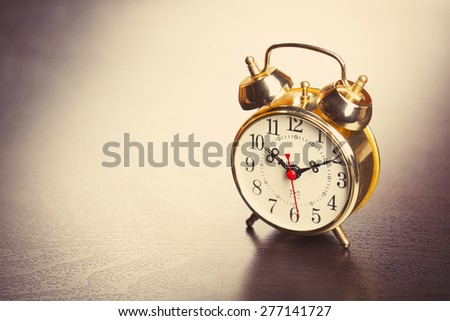 Vintage alarm clock with copyspace - stock photo