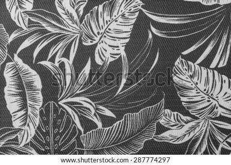 Vintage aloha Hawaiian shirt fragment in tones of black, shite, and gray. - stock photo