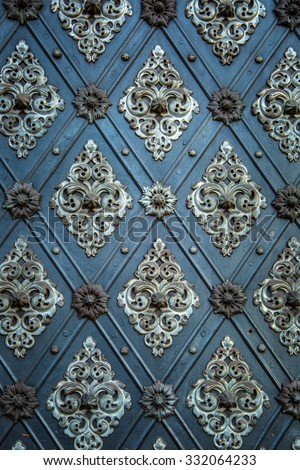Vintage ancient background. Rustic ancient doors pattern medieval repetitive ornaments. - stock photo