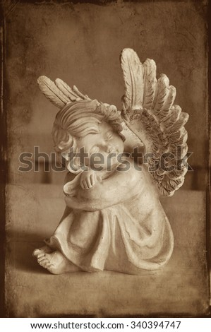 Vintage angel with wings dreaming. - stock photo