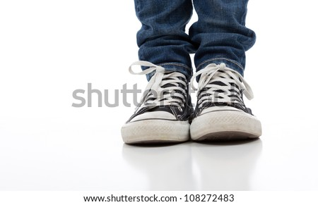 Vintage, antique athletic shoes on a white background with jeans - stock photo