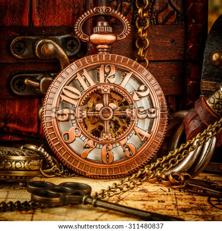 Vintage Antique pocket watch on an ancient world map in 1565.. - stock photo