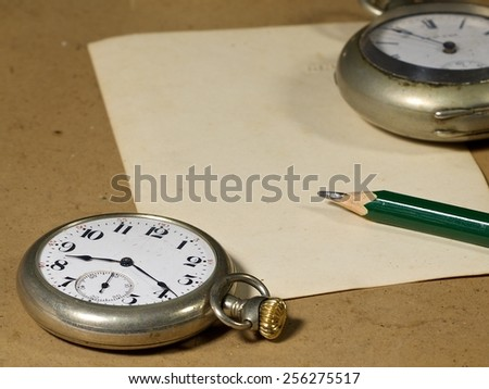 Vintage Antique pocket watch on pose card  - stock photo