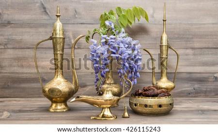 Vintage arabic jug, vase, lamp, tea pot. Fruits and flowers. Golden oriental decorations - stock photo