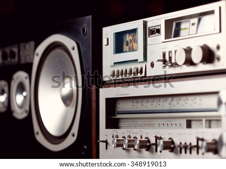 Vintage audio stereo rack with cassette tape deck receiver and speaker, angled view - stock photo