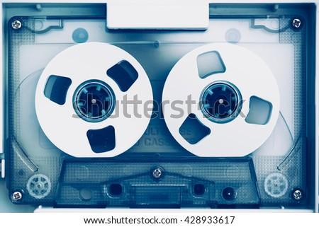 vintage audio tape compact cassette, blue tone - stock photo