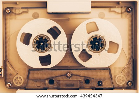 vintage audio tape compact cassette, sepia tone - stock photo