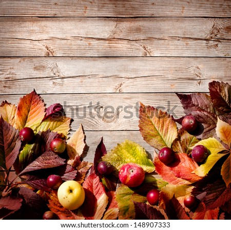 Vintage Autumn border from ashberry and and fallen leaves on old wooden table/ Thanksgiving day concept - stock photo