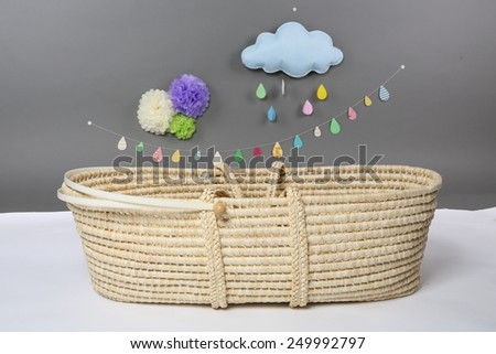 Vintage baby wicker Cot on gray background - stock photo