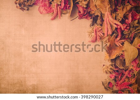 Vintage backdrop image with dried flower potpourri and textured background.  Room for copy.  - stock photo
