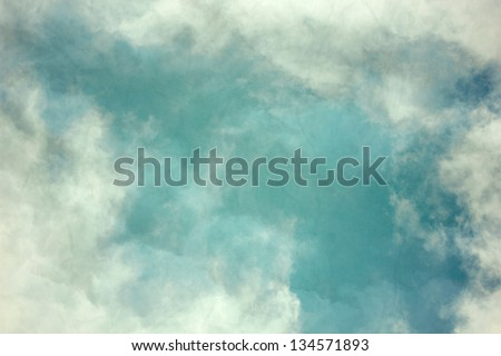 Vintage background in the blue shade with clouds - stock photo