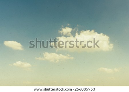 Vintage background of blue cloudy sky - stock photo