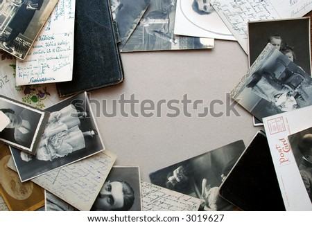 Vintage background with a frame of old postcards, old family photos and old notebooks - stock photo