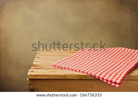 Vintage background with empty wooden table and tablecloth - stock photo