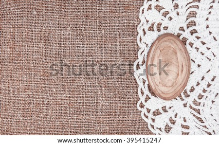 Vintage background with lace on the old rude burlap - stock photo