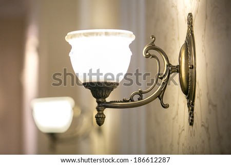 Vintage background with lighting retro lamp on wall in the dining room. shadows - stock photo