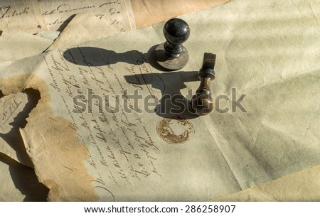 Vintage background with old paper, letters and two wooden rubber stamps - stock photo