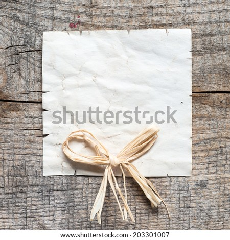 Vintage background with old paper on wooden background - stock photo