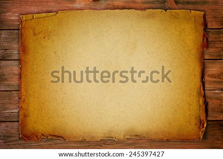 vintage background with old paper on wooden board - stock photo